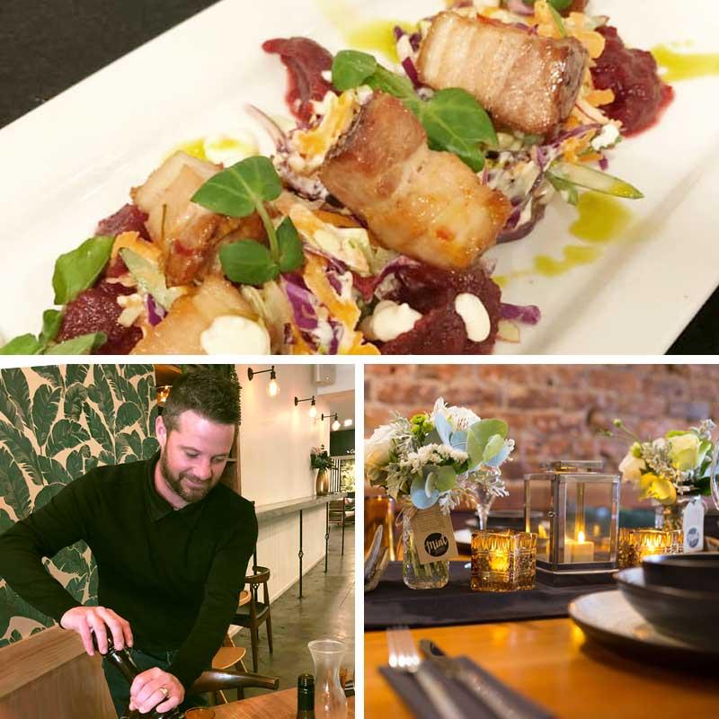 Pork Belly. Waiter serving platter. Table setting